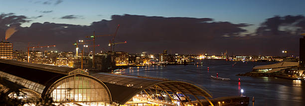 Aerial view of illuminated Amsterdam Central Station at dusk, panorama:スマホ壁紙(壁紙.com)