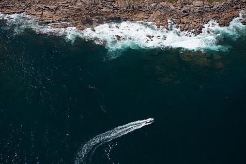 Sailboat「Aerial view of a boat passing near rocky coastline」:スマホ壁紙(8)
