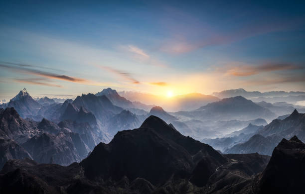 Aerial view of misty mountains at sunrise:スマホ壁紙(壁紙.com)