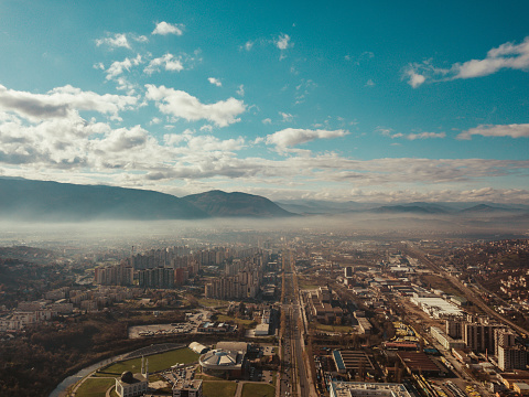 Landscape Arch「Aerial view of city Sarajevo above the clouds. Sunny day in Sarajevo with a blue sky and clouds.」:スマホ壁紙(18)