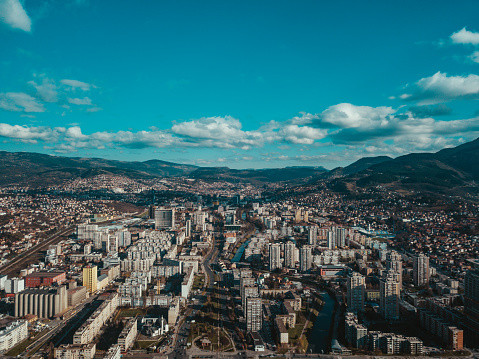 Landscape Arch「Aerial view of city Sarajevo with a blue sky and clouds.」:スマホ壁紙(19)