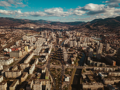 Landscape Arch「Aerial view of city Sarajevo with a blue sky and clouds.」:スマホ壁紙(17)