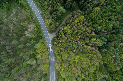 Freight Transportation「Aerial view of rural road through forest, Franconia, Bavaria, Germany」:スマホ壁紙(1)