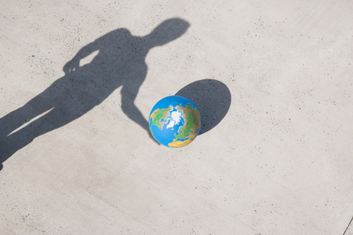 Planet Earth「Aerial View of man with shadow and globe」:スマホ壁紙(0)