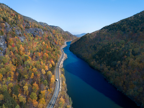 Adirondack Mountains「Aerial view of a road with autumn leaves changing」:スマホ壁紙(1)