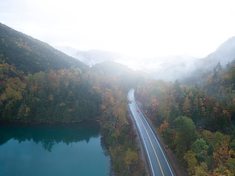 Adirondack Forest Preserve「Aerial view of a road with autumn leaves changing」:スマホ壁紙(3)