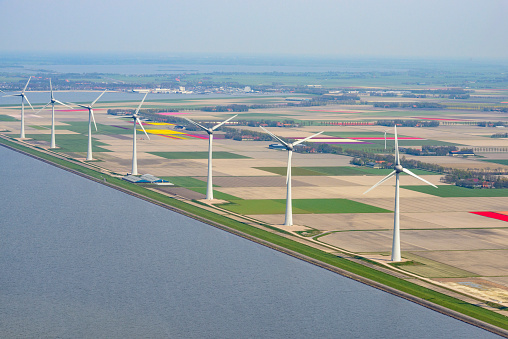 Netherlands「Aerial view on wind turbines in front of fields of tulip flowers growing in spring in Holland」:スマホ壁紙(8)