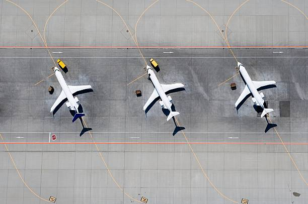 Aerial view of three airplanes in a row:スマホ壁紙(壁紙.com)