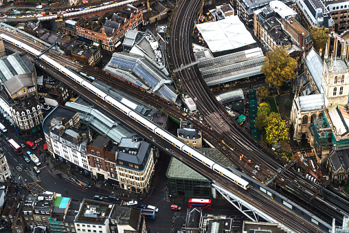 Central London「Aerial View of London city through The Shard's observation point in UK - High angle view of a public overground train moving on railroad track in London」:スマホ壁紙(9)