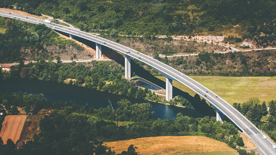 Bugey「Aerial view of French curved elevated highway road crossing wild Ain river in summer season」:スマホ壁紙(16)