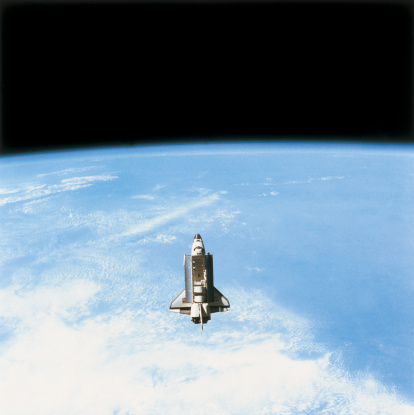Spinning「Aerial view of the space shuttle in orbit above earth」:スマホ壁紙(9)