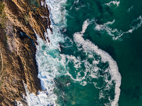Rocky Coastline「Aerial view of sea waves crashing against rocky coast」:スマホ壁紙(6)