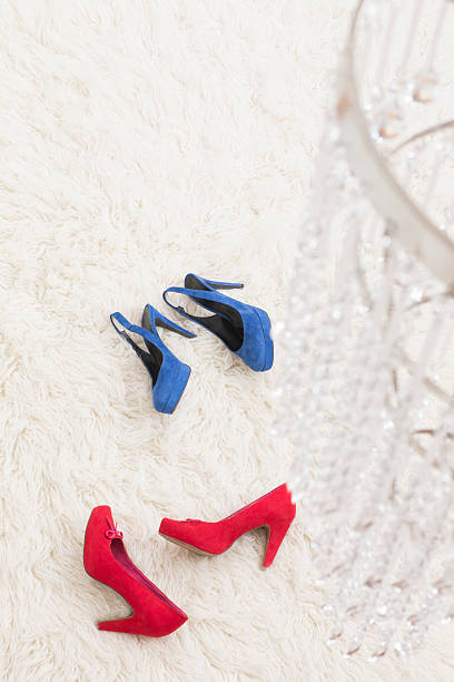Red and Blue High Heels laying on white carpet:スマホ壁紙(壁紙.com)
