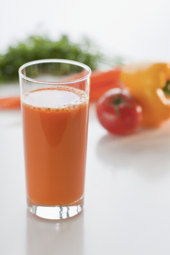 Vegetable Juice「Glass of carrot juice with vegetable in background」:スマホ壁紙(12)