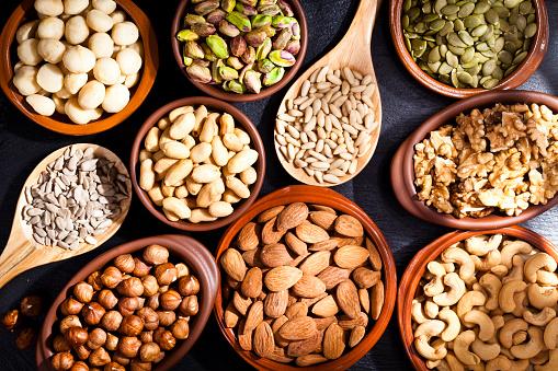 Peanut - Food「Nuts assortment on rustic wood table.」:スマホ壁紙(16)