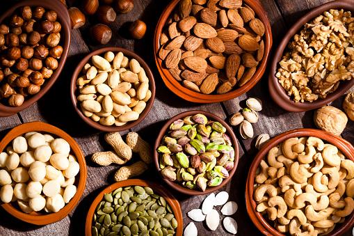 Walnut「Nuts assortment on rustic wood table.」:スマホ壁紙(4)