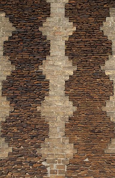背景「Intricate stone cladded wall on a house in Downham Market, Norfolk, UK」:写真・画像(10)[壁紙.com]