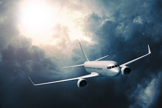 Passenger airplane flying in storm:スマホ壁紙(壁紙.com)