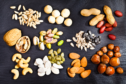 Pine Nut「Nuts collection on dark slate background」:スマホ壁紙(18)