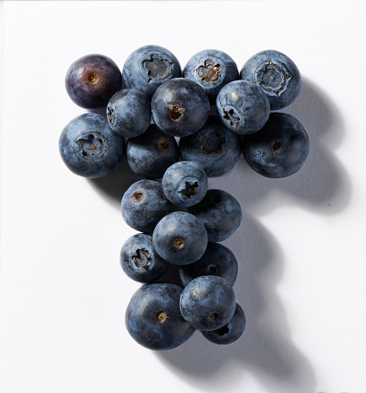 Part of a Series「A close up image of blueberries in the shape of a letter T」:スマホ壁紙(10)