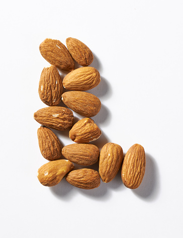 Almonds「A close up image of almond nuts in the shape of a letter L」:スマホ壁紙(2)
