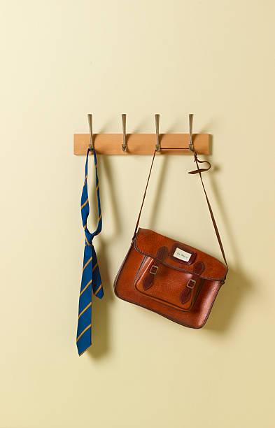 School tie and satchel on coat rack:スマホ壁紙(壁紙.com)