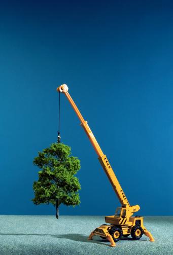 Deforestation「Toy crane 'lifting' artificial tree, close-up」:スマホ壁紙(6)