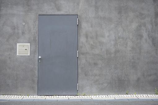 Concrete Wall「Grey steel door at concrete wall」:スマホ壁紙(4)