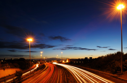 City Street「Rush hour on motorway with blurred headlights at dusk」:スマホ壁紙(16)