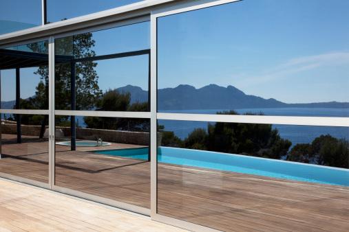 Balearic Islands「Windows reflecting infinity pool and skyline」:スマホ壁紙(17)