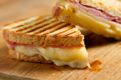 Sandwich「Cheese and ham panini sandwiches on a wooden board」:スマホ壁紙(2)