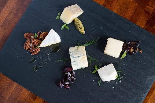 Cheese Board「Cheese and herbs on cutting board」:スマホ壁紙(17)