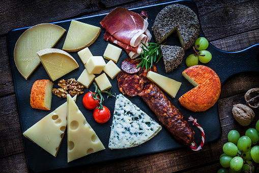 Salumeria「Cheese and cold meat board shot from above on wooden table」:スマホ壁紙(18)