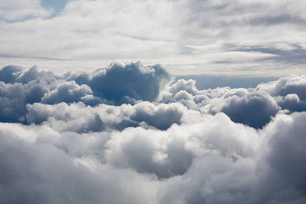 Fluffy white clouds from above:スマホ壁紙(壁紙.com)
