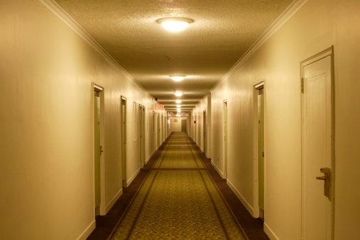 Diminishing Perspective「View down hotel corridor with illuminated lamps on ceiling」:スマホ壁紙(15)
