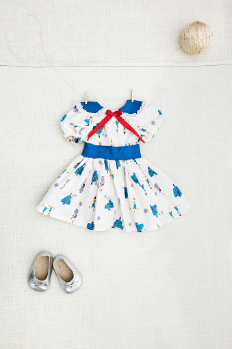 Dress「Girl's dress and shoes hanging on wall」:スマホ壁紙(4)