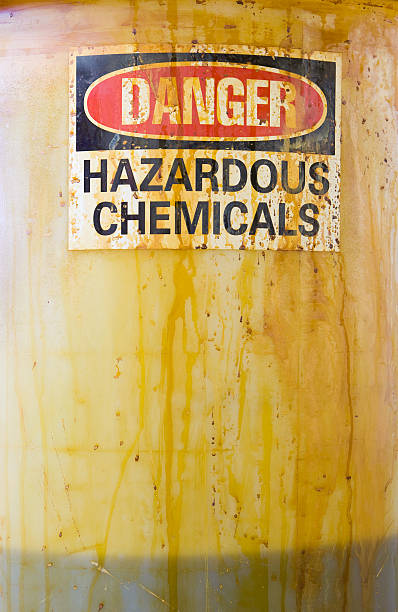 Danger Hazardous Chemicals Sign on a Translucent Barrel with Liquid:スマホ壁紙(壁紙.com)
