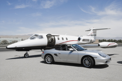 Wealth「Convertible and private jet on landing strip.」:スマホ壁紙(5)