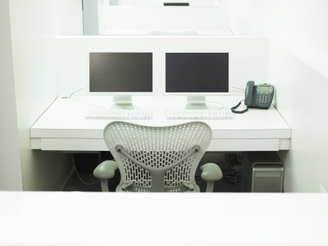 Two Objects「Two computers and phone atop desk in office」:スマホ壁紙(6)
