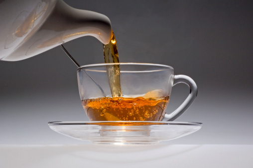 Boiling「Tea pouring from a white china pot into glass cup.」:スマホ壁紙(10)