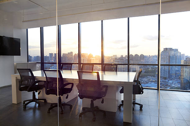 Meeting room with glass wall cityscape and sunset:スマホ壁紙(壁紙.com)