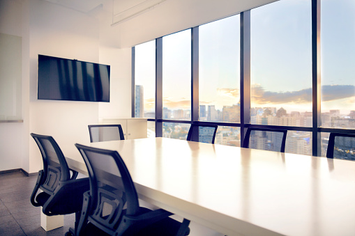 Meeting「Meeting room with view of cityscape sunset」:スマホ壁紙(16)