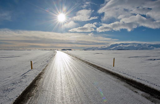 Frozen「Tire trucks on rural road in snowy landscape」:スマホ壁紙(9)