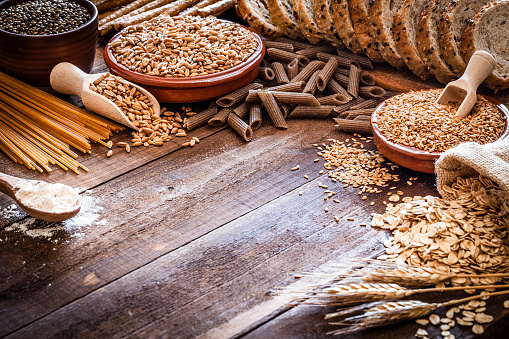 Brown Rice「Wholegrain food still life shot on rustic wooden table」:スマホ壁紙(13)