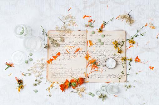 Marigold「Dried medical plants and globuli on old recipe book」:スマホ壁紙(12)