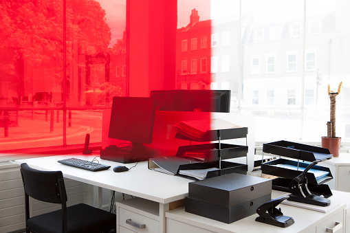 Computer「Office desk with red gel overlapping a corner of the image」:スマホ壁紙(14)