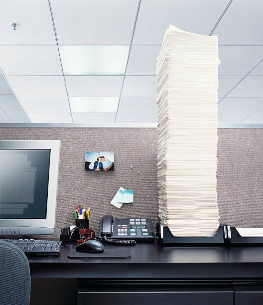 Office desk with papers piled high in 'In' box:スマホ壁紙(壁紙.com)