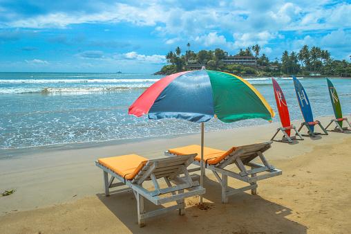 Sri Lanka「Beach chairs, Umbrella and Surfboards on beach」:スマホ壁紙(17)