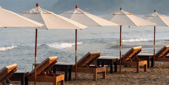 Sayulita「Beach chairs and white umbrellas lined up on the beach along the ocean; sayulita mexico」:スマホ壁紙(2)