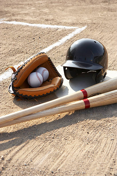 Baseball glove, balls, bats and baseball helmet at home plate:スマホ壁紙(壁紙.com)